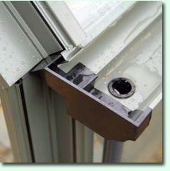 Wide aluminium guttering, complete with PVC downpipe